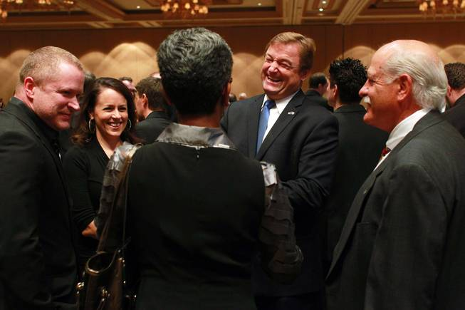 Sen. Dean Heller talks with guests at at the Nevada Development Authority's annual luncheon Friday, Dec. 7, 2012.