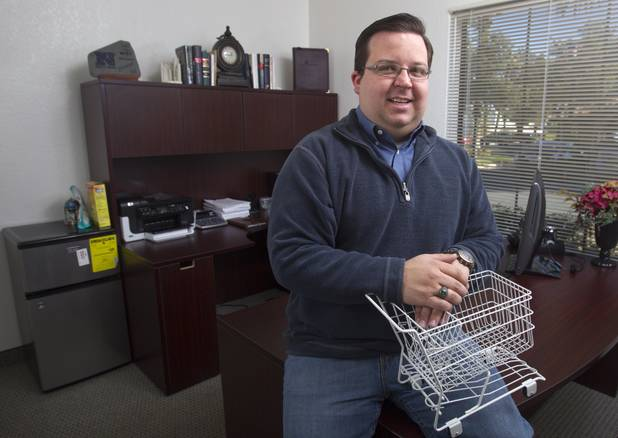 Bryan Wachter, lobbyist for the Retail Association of Nevada, poses in his office. Wachter says fewer stores are closing now than during the depths of the recession, but the economy still isn't fully recovered.
