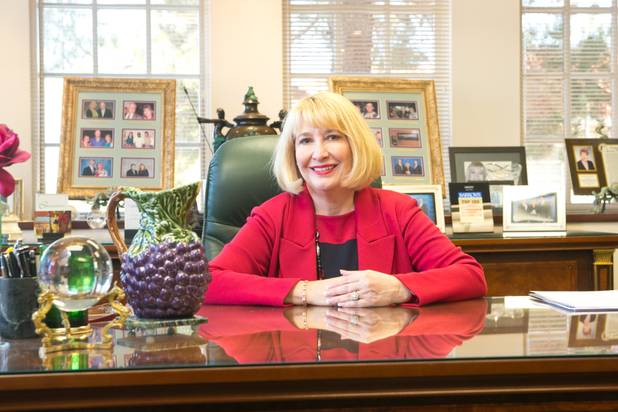 Deborah Danielson, owner of the Danielson Financial Group, poses in her office. Danielson was the first woman in Nevada to be certified as a fund specialist. She has been working in the investment industry since 1981.