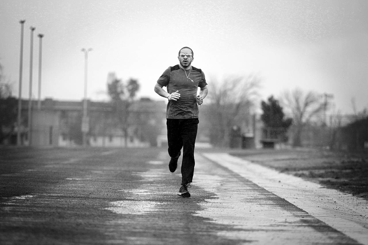 Arturo Martinez-Sanchez runs on a track at the Cheyenne Sports Complex in North Las Vegas on the morning of March 8, 2013. Because of a traumatic brain injury in April 2012, he has only recently begun running again.