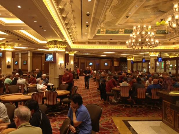 The Venetian poker room is busy Monday, July 22, 2013, despite a planned boycott by poker professionals in response to owner Sheldon Adelson's negative remarks about online gambling.