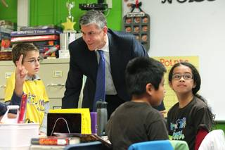 U.S. Secretary of Education Arne Duncan talks with students during a visit to Walter Bracken Elementary School Wednesday, Dec. 4, 2013. Duncan also took part in a roundtable discussion with various school district principals.