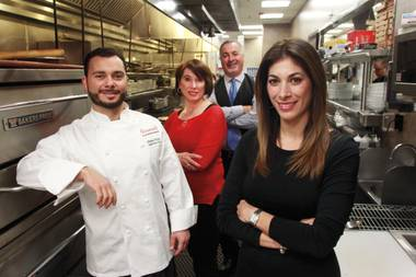The Ferraro family works together at Ferraro's Italian Restaurant and Lounge. From left are Mimmo, Rosalba, Gino and Theresa.