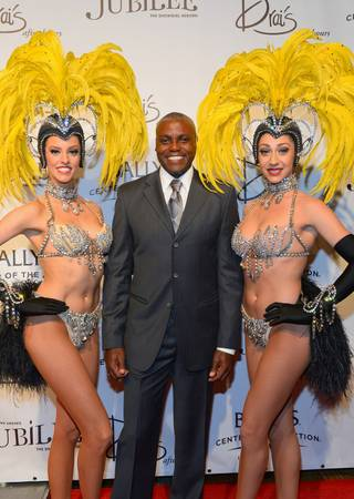 Carl Lewis attends the grand reopening of