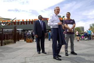 Senate Majority Leader Harry Reid (D-NV) finishes a tour of downtown Las Vegas with Zappos CEO Tony Hsieh, right, in front of the Las Vegas Container Park Tuesday, April 15, 2014.