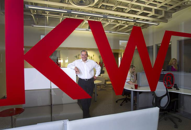 "Jaime Velez, broker and operating partner, poses in the ""Bull Pen,"" an Internet lounge and workstation, at the Keller Williams Southern Nevada new offices Thursday, April 24, 2014. The lounge also provides computers with wired connections for brokers that don't have a laptop. The office celebrated their grand opening Wednesday (April 30)."