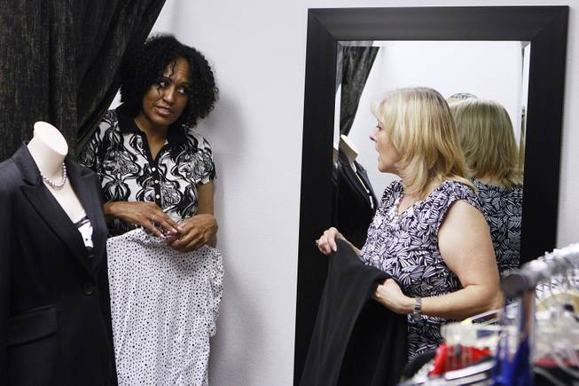 Sonji McTear and Theresa Anderson discuss come of McTear's clothing options at Dress for Success Saturday, May 31, 2014.