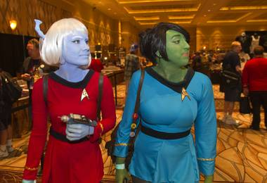 Stephanie Rowe, left, dressed as an Andorian, and Victoria Blake, as an Orion, both of Phoenix, look over a vendors area during the 13th annual Official Star Trek Convention at the Rio Thursday, July 31, 2014. The convention, expected to attract 15,000 Trekkies, runs through Sunday.