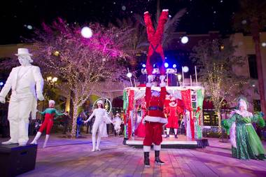 KriStef Brothers Kristofer Saly, top, and Stefan Linden (Santa) perform during the Winter PARQ Show in the Linq Promenade Sunday, Dec. 14, 2014. The free performances  are held daily on the hour from 5 p.m. to 9 p.m. until Dec. 27.