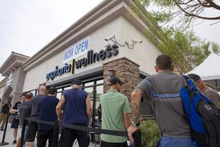 People wait in line to purchase medical marijuana during the opening of Euphoria Wellness, 7785 S. Jones Blvd., the first marijuana dispensary in Las Vegas, Aug. 26, 2015. Euphoria is among dozens of stores that will begin recreational marijuana sales in Nevada on Saturday, July 1, 2017.