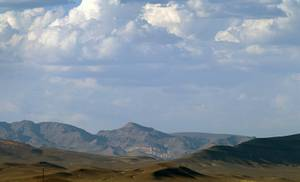 A view of Yucca Mountain, center, as seen from Amagosa ...