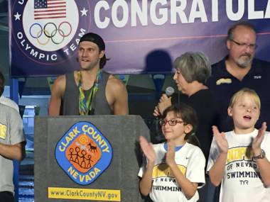 Las Vegas Olympian Cody Miller stands with the gold and bronze medals he won during the 2016 Summer Olympics in Rio de Janeiro during a recognition ceremony at the Desert Breeze Aquatic Facility, Monday, Aug. 29, 2016.
