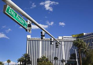 The street sign for Elvis Presley Boulevard is shown at Paradise Road Wednesday, Jan. 11, 2017. Elvis Presley Boulevard, formerly Riviera Boulevard, is four-tenths of a mile and runs from the Las Vegas Strip to Paradise Road.