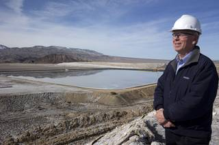 John Mayes, site manager for the Silver Peak lithium mine,  looks over the mines evaporation ponds during a tour of the mine near Tonopah, Nev. Monday, Jan. 30, 2017.