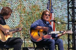 John Fogerty and his son perform a couple songs during a groundbreaking ceremony for a new Crisis Intervention Center and Public Memorial at Veterans Village #2 in Downtown Las Vegas on September 28, 2017.
