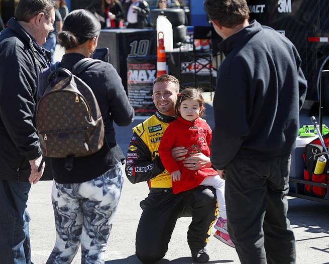Driver Matt DiBenedetto poses with a fan before the NASCAR Pennzoil 400 race at the Las Vegas Motor Speedway Sunday March 4, 2018.