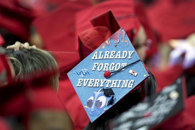 Decorated Graduation Caps Reflect Joy Angst Of Unlv Students Las Vegas Sun Newspaper Though the university bookstore is currently closed, interested students can still purchase academic regalia (cap and gown) online directly case western reserve university regalia is made in america by oak hall cap & gown. decorated graduation caps reflect joy