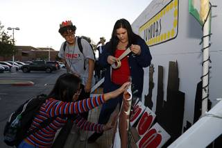 Mary Kaye Visaya, left, Arturo Ayala and Clarissa Peters work on a Juniors homecoming float before a football game against Desert Pines at Legacy High School Friday, Oct. 12, 2018.