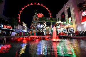 The High Roller is seen over the holiday display at ...