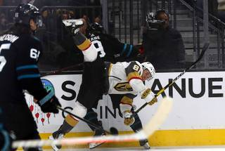 Vegas Golden Knights center Jonathan Marchessault (81) is upended by San Jose Sharks left wing Evander Kane (9) during the first period at T-Mobile Arena Thursday, Jan 10, 2019.