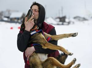 Nicolas Petit hugs one of his dogs before they leave ...
