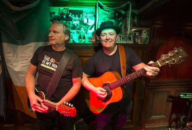 David Browne, left, and Dave Rooney of The Black Donnellys pose for a photo after a performance at Ri Ra Irish Pub at the shoppes at Mandalay Place in Las Vegas on Thursday, May 2, 2019.
