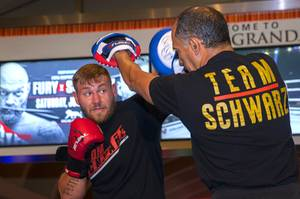 Heavyweight boxer Tom Schwarz of Germany works on this timing ...