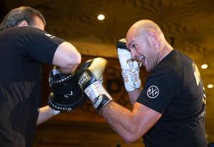 Heavyweight boxer Tyson Fury, right, of England works on his ...