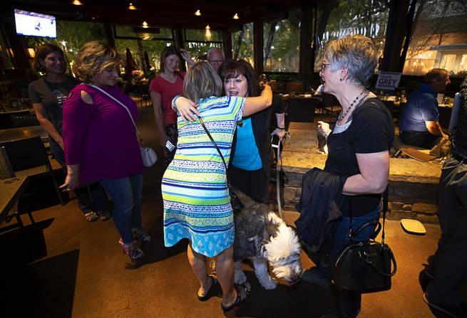 City Council Ward 2 candidate Hilarie Grey, center, gets hugs from supporters at her election watch party at Lazy Dogs in Downtown Summerlin Tuesday, June 11, 2019. Grey came in second place behind Victoria Seaman.
