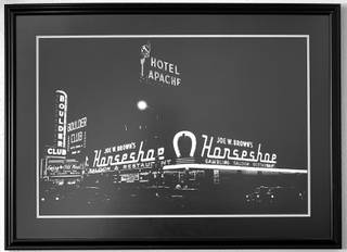 A 1952 photo shows the Hotel Apache sign above the Horseshoe in downtown Las Vegas Wednesday, July 24, 2019. On Monday, July 29, TLC Casino Enterprises will open 81 historically-themed rooms as Hotel Apache, the original name of the hotel when it was built in 1932.