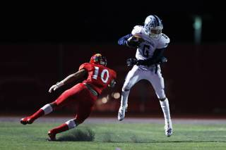Centennial wide receiver Gerick Robinson (6) dodges  Arbor View defensive back Devin Ramirez (10) during a game at Arbor View high school, Friday, Sept. 27, 2019.