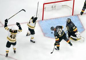 Bruins' David Backes (42) and Chris Wagner celebrate after Torey Krug scored against the Vegas Golden Knights during the second period of an NHL hockey game Tuesday, Oct. 8, 2019, in Las Vegas.