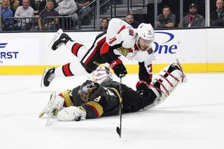 Vegas Golden Knights goaltender Marc-Andre Fleury (29) defends against Ottawa Senators center Chris Tierney during the first period of an NHL hockey game Thursday, Oct. 17, 2019, in Las Vegas.