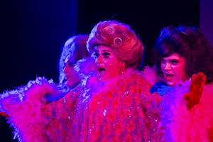 From left, Jay Joseph as Lauren Jittus, Bert Anderson as Lollie Gagger and Mickey Roark as Benjamin Ray Dawsen/Sharon De Wealth perform during a production of