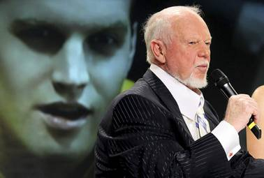 "In this March 24, 2010, file photo, hockey personality Don Cherry, right, speaks during a news conference as actor Jared Keeso is displayed on a video screen while playing Cherry in the bio film ""Keep Your Head Up Kid: The Don Cherry Story"" in Toronto. Sportsnet cut ties with Cherry on Monday, Nov. 11, 2019, after the veteran hockey commentator called new immigrants ""you people"" on his ""Coach's Corner"" segment while claiming they do not wear poppies to honor Canadian veterans."