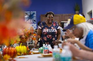 Joann Woods dances during a North Las Vegas Police community engagement event at Rose Garden Senior Apartments, Wednesday, Nov. 13, 2019. As part of the event, officers served an early Thanksgiving feast to local seniors.
