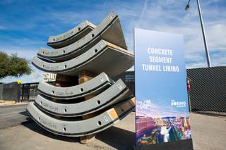 Sections of the concrete tunnel lining is set up for display at the entrance to the 40-feet deep hole. The Boring Company will begin tunnel work for the Las Vegas Convention Center's underground people-mover project today, Friday Nov. 15, 2019.