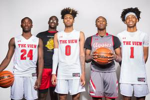 Players of the Arbor View High basketball team, from left Larry Holmes, Jaylon Lee, Donavan Yap, David Moore and Mikey Medlock, take a portrait during the Las Vegas Sun's High School Basketball Media Day at the Red Rock Resort and Casino, Oct. 28, 2019.