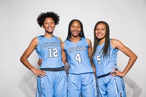 Players of the Centennial High basketball team, from left Aishah ...