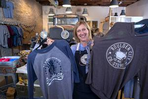 Tara Leon-Bertoli poses with Boulder City-themed clothing at the Boulder City Company Store in Boulder City Wednesday, Nov. 27, 2019. Tara co-owns the business with her husband Dr. Troy Bertoli.