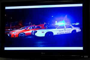 A photo of the scene is shown during a media brief by North Las Vegas Police Chief Pamela Ojeda, Tuesday Jan. 7, 2020. Suspect Jamari Tarver was involved in a vehicle pursuit in North Las Vegas on Jan 2nd, 2020, that ended with him being killed by police.