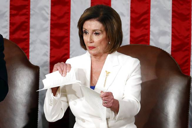 Image result for pelosi rips up sotu speech in chambers""