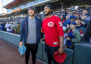 Kris Bryant, left, third baseman and outfielder for the Chicago Cubs, and Amir Garrett, a pitcher for the Cincinnati Reds, pose for a photo during a batting practice at the Las Vegas Ballpark in Summerlin Thursday, Feb. 6, 2020.  Bryant graduated from Bonanza High School. Garrett began his high school career at Sierra Vista High School.
