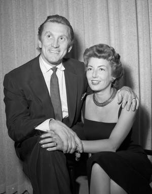 Kirk Douglas and Anne Buydens pose for wedding photos at the Sahara Hotel in Las Vegas May 30, 1954. (Las Vegas News Bureau)