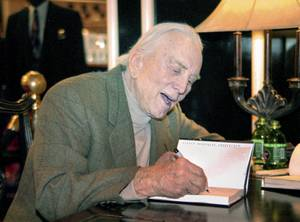 Actor Kirk Douglas greets fans and signs copies of his ...