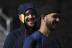 Chicago Cubs outfielder Kris Bryant laughs as he and other Major League Baseball players take part in an open batting practice Thursday, February 6, 2020, at Las Vegas Ballpark.