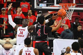 UNLV Rebels forward Cheikh Mbacke Diong (34) defends Fresno State Bulldogs guard Niven Hart (4) during their NCAA Mountain West Conference basketball game Saturday, February 8, 2020, at the Thomas & Mack Center in Las Vegas. UNLV won the game 68-67 to end a four-game losing streak.