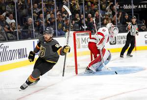 Vegas Golden Knights center Chandler Stephenson (20) celebrates his goal past Carolina Hurricanes goaltender James Reimer (47) during the third period of an NHL hockey game at T-Mobile Arena Saturday, Feb. 8, 2020.
