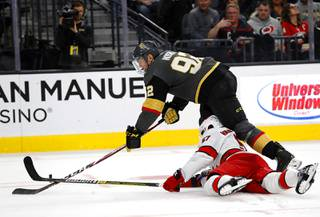 Vegas Golden Knights left wing Tomas Nosek (92) fights for the puck over Carolina Hurricanes defenseman Trevor van Riemsdyk (57) during the third period of an NHL hockey game at T-Mobile Arena Saturday, Feb. 8, 2020.