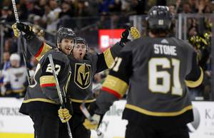 Golden Knights center Jonathan Marchessault, rear, celebrates after scoring against the St. Louis Blues with defenseman Shea Theodore (27) and right wing Mark Stone (61) during the second period of an NHL hockey game Thursday, Feb. 13, 2020, in Las Vegas.